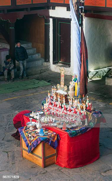 courtyard altar w torma flour and butter offerings - mani rimdu festival stock pictures, royalty-free photos & images