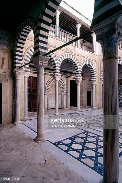Courtyard and portico in the Zaouia of Sidi Abid el-Ghariani, Kairouan . Tunisia, 14th century.