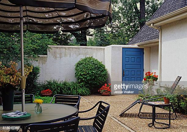 Courtyard area with high stucco walls