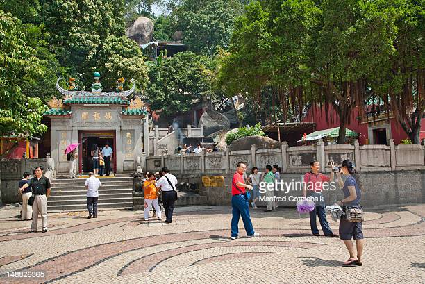 courtyard at a-ma temple, dedicated to goddess of seafarers. - macao stock pictures, royalty-free photos & images