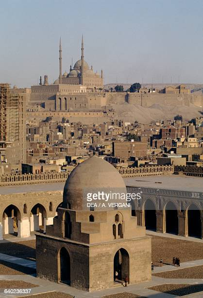 Courtyard with 13th century fountain Mosque of Ahmad ibn Tulun The great Mosque of Muhammad Ali Pasha or Alabaster Mosque in the background Cairo...