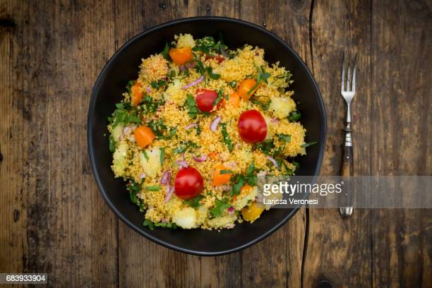 Couscous Salad with tomato, parsley, cucumber ans red onions