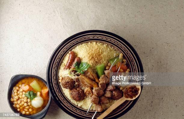 couscous with meatballs,merguez and brochettes - couscous photos et images de collection