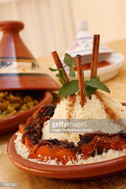 couscous with vegetables in a tajine - couscous marocain photos et images de collection