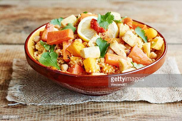 Couscous with vegetables, including carrots, parsnips, pumpkin, shallots, apricots and chickpeas
