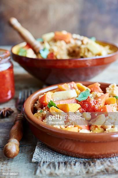 couscous with vegetables, including carrots, parsnips, pumpkin, shallots, apricots and chickpeas - couscous photos et images de collection