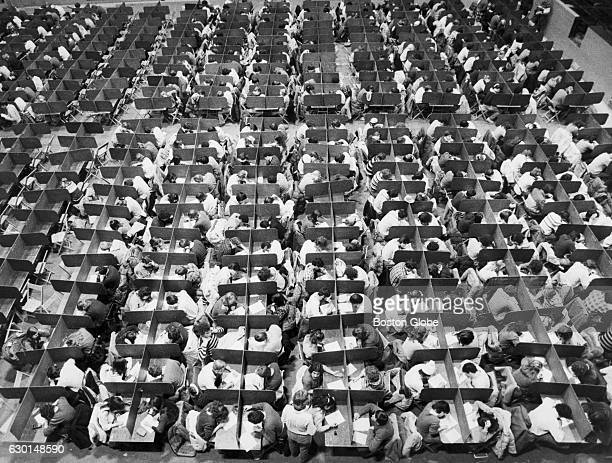 Cousens Gymnasium at Tufts University in Medford Mass is packed with 550 students of Economics I taking their finals on Dec 21 1981