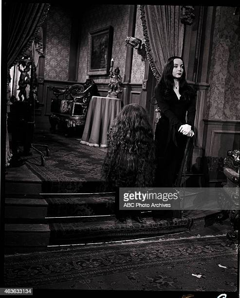 cousin itt visits the addams family stock photos and pictures