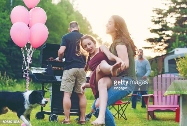 cousins just fooling around - funny bbq stock pictures, royalty-free photos & images