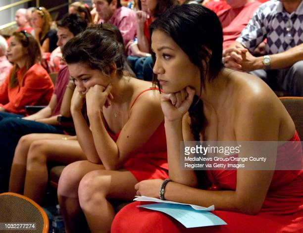 Cousins of Tyler Macleod Jenna Solis center and Savannah Clark right listen as family and friends of Tyler speak before the Huntington Beach City...