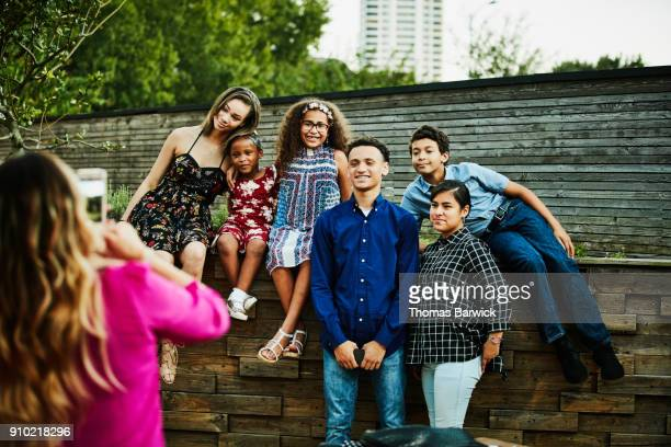 Cousins posing for family portrait after dinner party