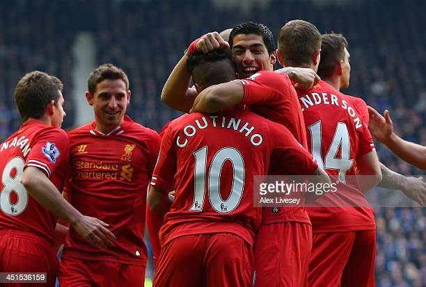 Coutinho of Liverpool celebrates scoring the opening goal with Luis Suarez during the Barclays Premier League match between Everton and Liverpool at...