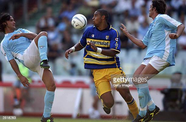 Couto of Lazio and Adriano of Parma battle for the ball during the Serie A match between Lazio and Parma at the Olympic Stadium September 21 2003 in...