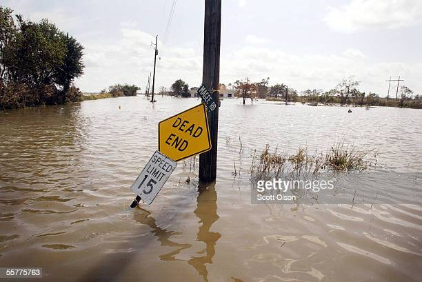 A coutry road is covered by flood waters left in the wake of Hurricane Rita September 26 2005 near Henry Louisiana Rita hit land as a Category 3...