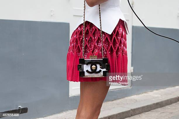 Couture Collector Inga Kozel wearing a couture Alaia top and skirt and Chanel bag day 2 of Paris Haute Couture Fashion Week Autumn/Winter 2014 on...