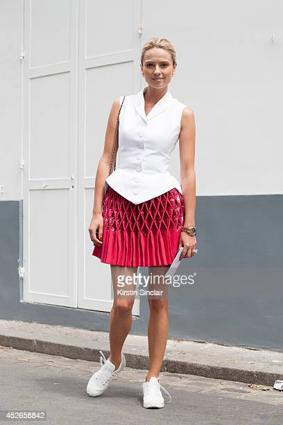 Couture Collector Inga Kozel wearing a couture Alaia top and skirt couture Chanel trainers and bag day 2 of Paris Haute Couture Fashion Week...