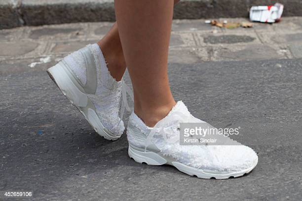 Couture Collector Inga Kozel wearing couture Chanel trainers day 2 of Paris Haute Couture Fashion Week Autumn/Winter 2014 on July 7 2014 in Paris...