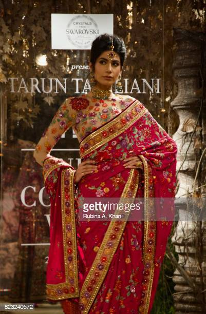 Couturier Tarun Tahiliani exhibits his bridal couture collection 201718 Tarakanna during FDCI's India Couture Week 2017 at the Taj Palace hotel on...