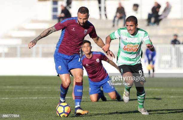 Cova da Piedade forward Hugo Firmino from Portugal with SC Covilha forward Raul Almeida from Portugal in action during the Segunda Liga match between...