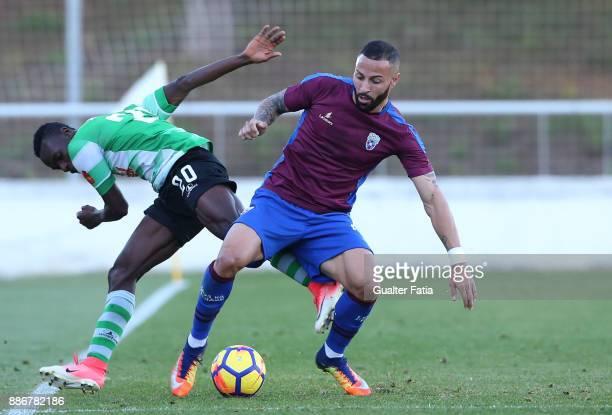 Cova da Piedade forward Hugo Firmino from Portugal with SC Covilha forward Sodiq Fatai from Nigeria in action during the Segunda Liga match between...