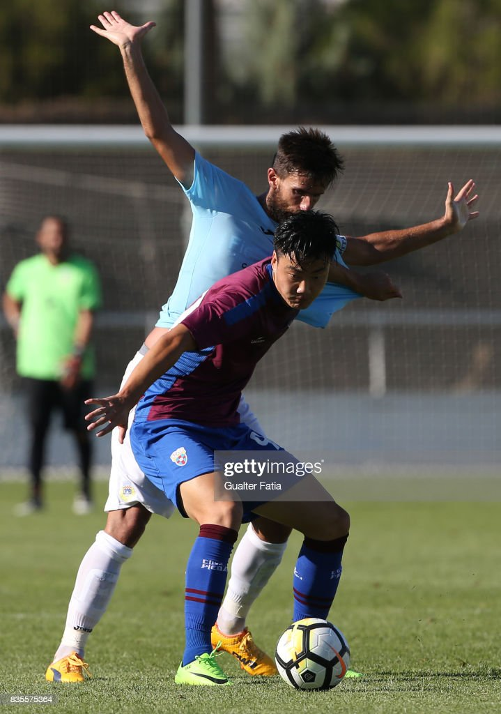 CD Cova da Piedade forward Yuhao Liu from China with FC Arouca defender Nuno Coelho from Portugal in action during the Segunda Liga match between CD Cova da Piedade and FC Arouca at Estadio Municipal Jose Martins Vieira on August 19, 2017 in Almada, Portugal.