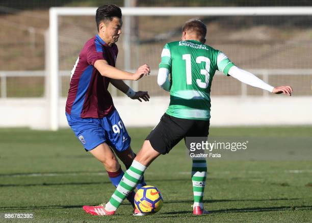 Cova da Piedade forward Yuhao Liu from China with SC Covilha defender Joel Vital from Portugal in action during the Segunda Liga match between CD...