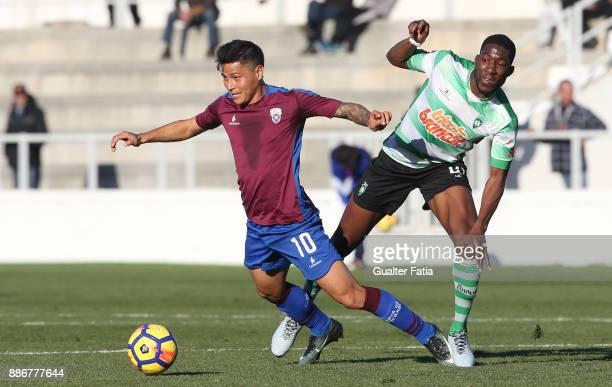 Cova da Piedade midfielder Robson from Brazil with SC Covilha midfielder Reinildo Mandava from Mozambique in action during the Segunda Liga match...