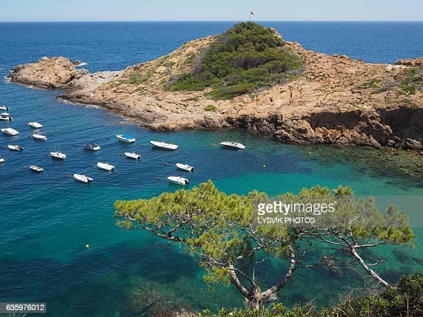 Cove filled with pleasure boats, Sa Tuna