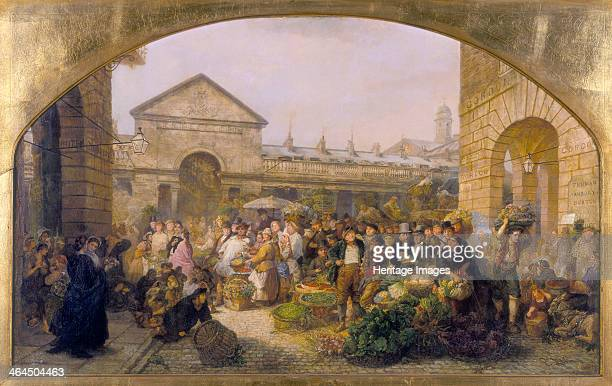 'Covent Garden Market' 1864 A view of the early morning bustle of the market with baskets of vegetables and people crowding the street This view is...