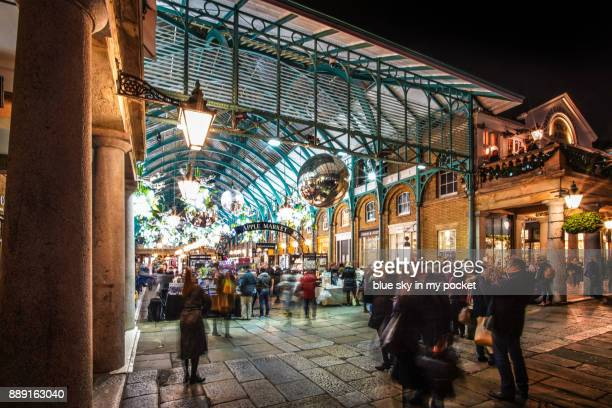 covent garden market, london at christmas time. - christmas scenes stock photos and pictures