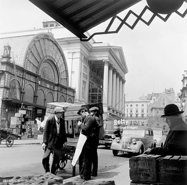 Covent Garden Market London c1952 Market traders stand outside the market by the Royal Opera House