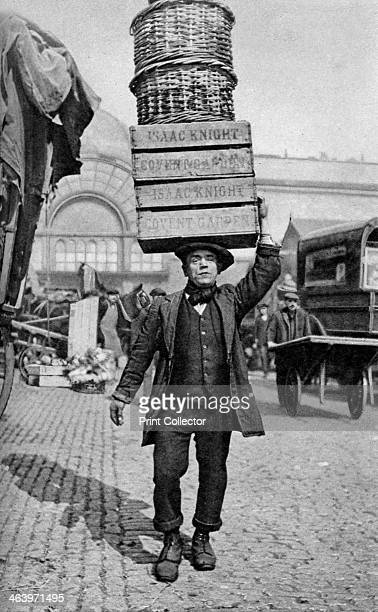 A Covent Garden market porter London c1922 A print from Peoples of all Nations Volume III edited by JA Hammerton The Fleetway House London c1922