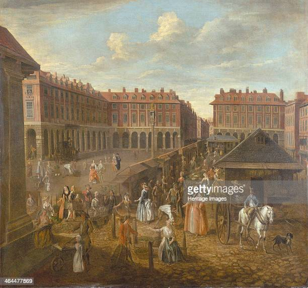 'Covent Garden Piazza and Market' c1725 This view is the first to show market buildings on the Piazza In the foreground people shop at the stalls...
