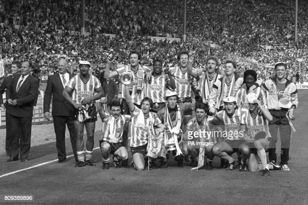 Coventry City celebrate with the FA Cup after winning 32 after extra time George Curtis John Sillett Cyrille Regis Keith Houchen Lloyd McGrath Trevor...