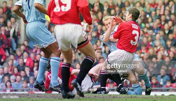 Coventry City defender David Busst breaks his leg resulting in extensive compound fractures to both the tibia and fibula of his right leg after...