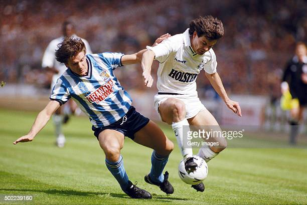Coventry City defender David Phillips challenges Steve Hodge of Spurs during the 1987 FA Cup Final between Coventry City and Tottenham Hotspur at...