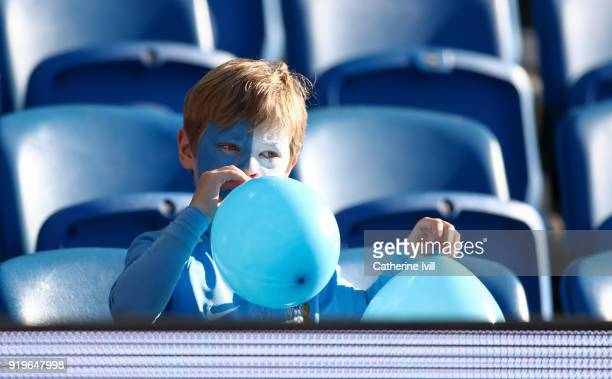 Coventry City fan blows up a balloon before the Emirates FA Cup Fifth Round match between Brighton and Hove Albion and Coventry City at Amex Stadium...