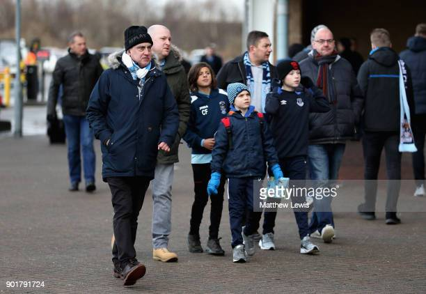 Coventry City fans arrive at the stadium prior to the The Emirates FA Cup Third Round match between Coventry City and Stoke City at Ricoh Arena on...