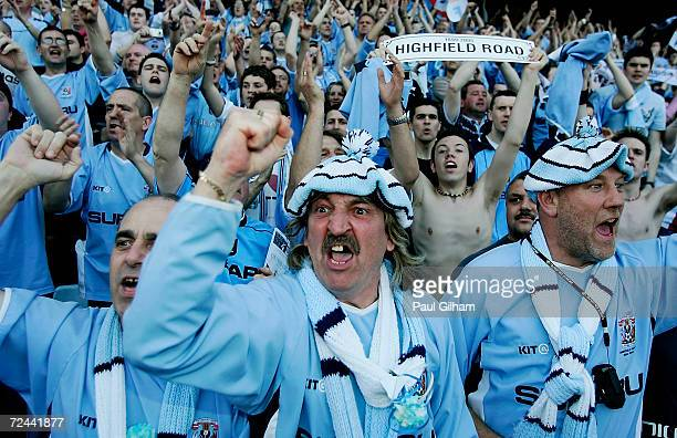 Coventry City fans celebrate at the end of their final match at Highfield Road during the CocaCola Championship match between Coventry City and Derby...
