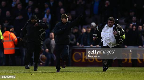 Coventry City fans invade the pitch in protest at the ownership of the club during the Sky Bet League One match between Northampton Town and Coventry...