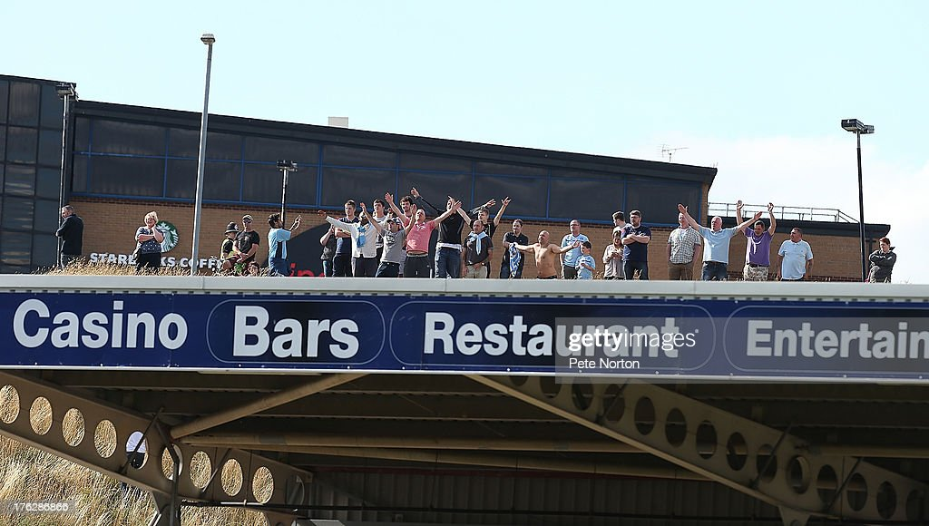 Coventry City fans watch the match from a hill behind the North Stand during the Sky Bet League One match between Coventry City and Bristol City at Sixfields Stadium on August 11, 2013 in Northampton, England.