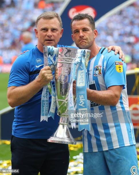 Coventry City manager Mark Robins and Michael Doyle of Coventry City celebrate with the trophy after the Sky Bet League Two Play Off Final between...