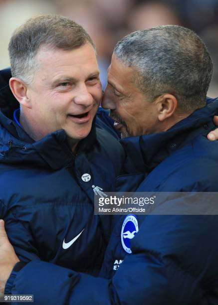 Coventry City manager Mark Robins embraces Chris Hughton manager of Brighton and Hove Albion during the FA Cup Fifth Round match between Brighton and...