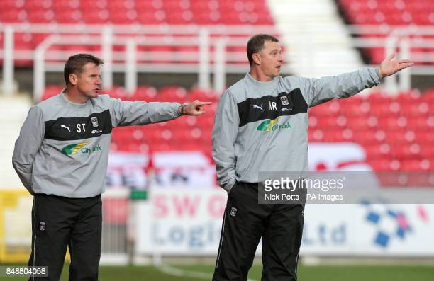 Coventry City manager Mark Robins w and first team coach Steve Taylor gesture to their players on the touchline