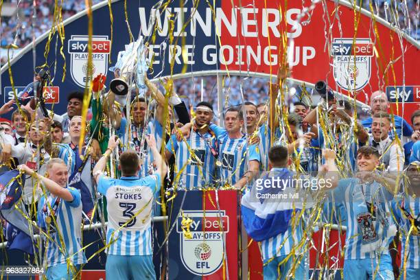 Coventry City players celebrate victory with the trophy after the Sky Bet League Two Play Off Final between Coventry City and Exeter City at Wembley...