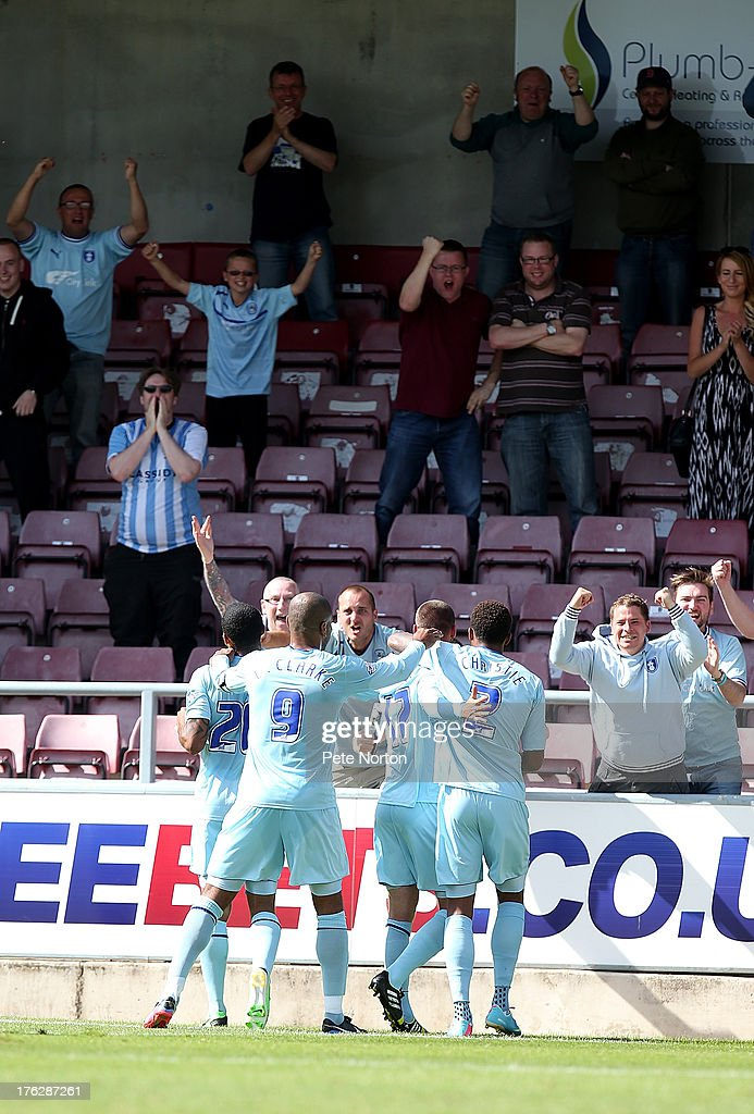 Coventry City players celebrate with fans after Billy Daniels had scored their 3rd goal during the Sky Bet League One match between Coventry City and Bristol City at Sixfields Stadium on August 11, 2013 in Northampton, England.
