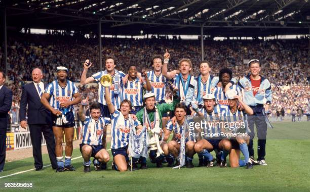 Coventry City players celebrate with the trophy after the FA Cup Final between Coventry City and Tottenham Hotspur at Wembley Stadium on May 16 1987...