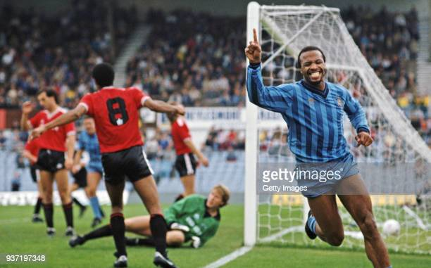 Coventry City striker Cyrille Regis celebrates after scoring during a 30 First Divsion win over Leicester City at Highfield Road on October 6 1985 in...