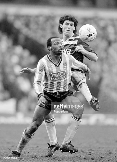 Coventry City striker Cyrille Regis is challenged by Aston Villa defender Martin Keown during their First Division match at Villa Park in Birmingham...