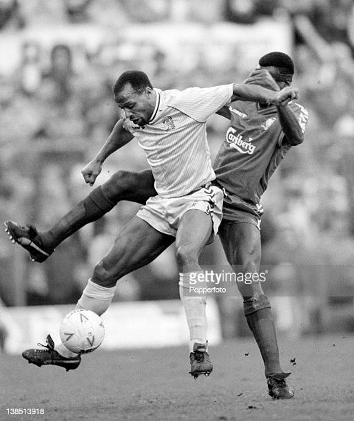 Coventry City striker Cyrille Regis is challenged by Wimbledon defender Eric Young during their First Division match at Highfield Road in Coventry...